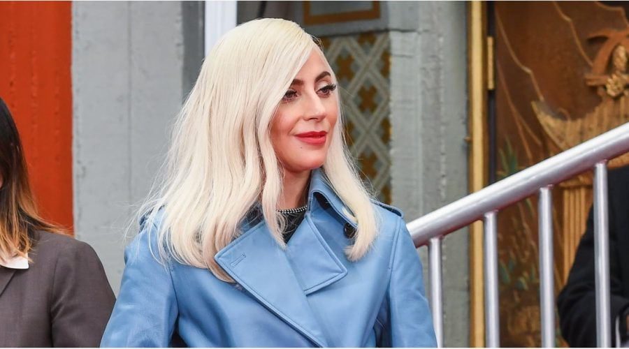 17d313155da Lady Gaga Reminds Us of Grace Kelly in This Striking Blue Leather Trench  Coat